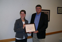 Employer Outreach Manager Laura Lutz presents a Partnership plaque to Dennis Stichter of Supreme Corporation
